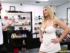 Olivia Austin ravages the foot fetishist store clerk for a discount