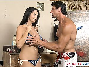 Ava Addams places his lollipop between her meaty orbs